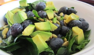 Citrusy Kale Salad w. blueberries and pepitas