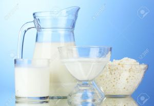 10589263-milk-sour-cream-and-cottage-cheese-on-blue-background-stock-photo
